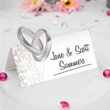 Hochzeitsdekoratin Tischkarten, Ringe und Blumen, zur Hochzeit